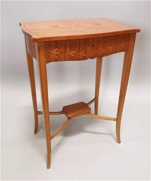Edwardian inlaid satinwood work table.