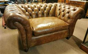 Hand dyed leather deep buttoned Chesterfield sofa.