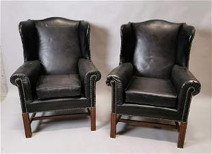 Pair of Edwardian leather wing back chairs.