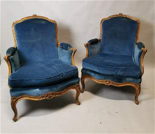 Pair of Edwardian carved walnut and upholstered
