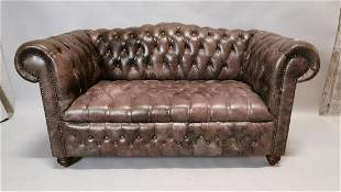 Leather Chesterfield two seater sofa.