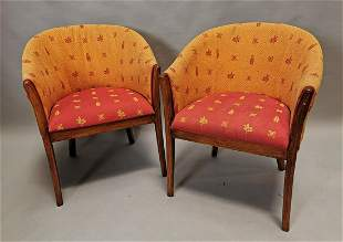 Pair of upholstered tub chairs.