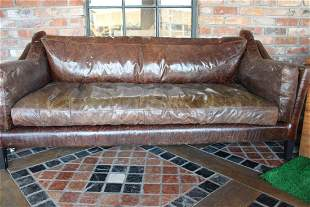 Retro style leather upholstered three seater sofa.
