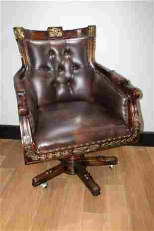 Gilded mahogany leather upholstered swivel armchair.