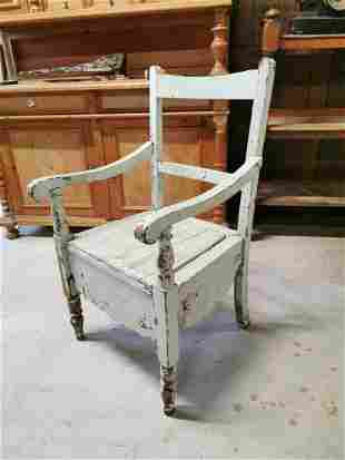 Early 20th C. painted pine commode chair.
