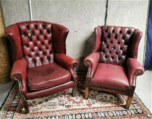 Near pair of Oxblood leather wingback armchairs.