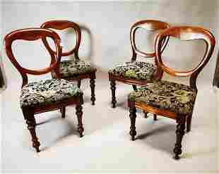 Set of four balloon backed mahogany dining chairs.
