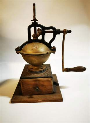Early 20th C.  coffee grinder.