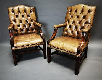 Pair of good quality deep buttoned armchairs.