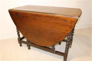 Late 19th C. oak double drop leaf table.