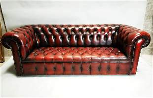 Leather oxblood Chesterfield sofa.