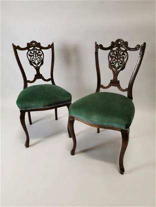 Pair of Edwardian mahogany carved armchairs.