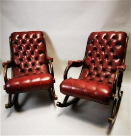 Pair of mid century mahogany and leather armchairs.