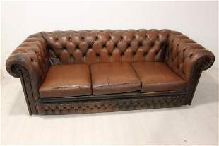 Leather chesterfield sofa.