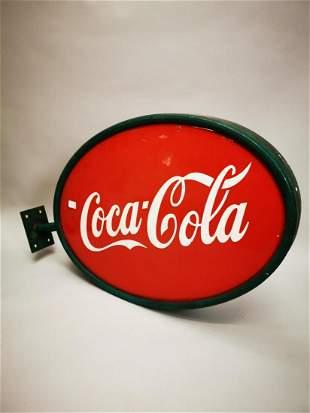 Coca Cola advertising sign.