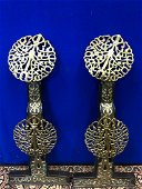 Pair of iron and cast brass fire place decorations W 28