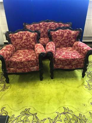 Generous two seater, dark framed with floral design