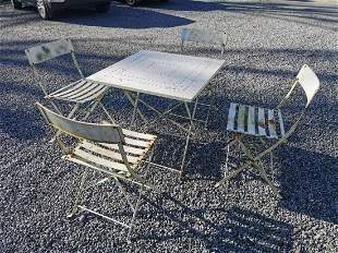 Metal garden table and four chairs.