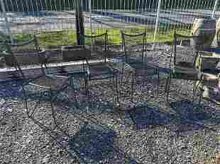 Set of four metal garden chairs.