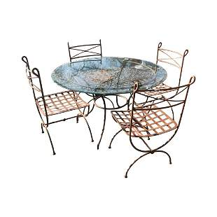 Wrought iron garden table and four chairs.