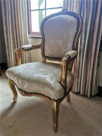 Giltwood upholstered open armchair.