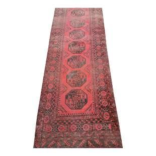 Hand woven Persian carpet runner.