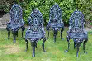 Set of four cast iron chairs.