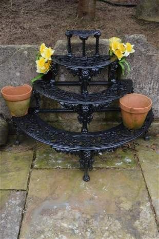 Cast iron four tiered plant stand.
