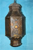 Pierced brass hanging candle holder