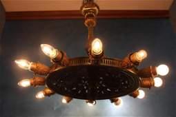 Unusual twelve branch brass chandelier
