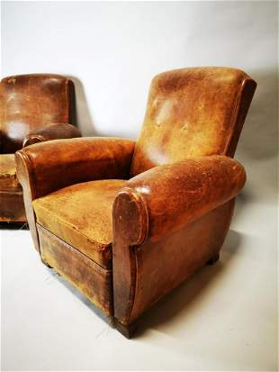 Pair of 1940's tanned leather upholstered club chairs.