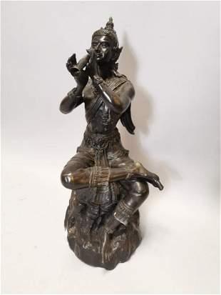 Bronze figure of oriental deity