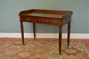 Victorian mahogany two drawer writing table on four