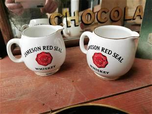 Pair of Jameson Whiskey advertising jugs.