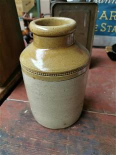 Glazed stoneware jar.