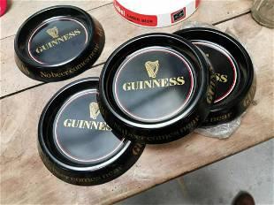 Seven Guinness advertising ashtrays.