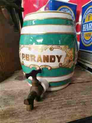 Early 20th C. miniature Brandy ceramic dispenser.