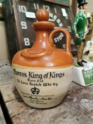 Scotch Whiskey stoneware flagon.