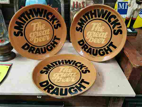 Three Smithwick's Draught advertising trays.