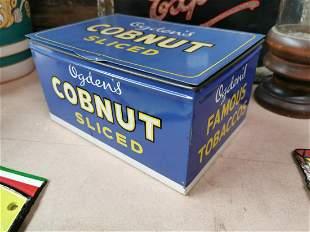 Ogden's tobacco advertising tin.