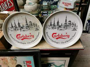 Two Carlsberg advertising drinks trays.
