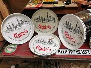 Four Carlsberg tin advertising drinks trays.