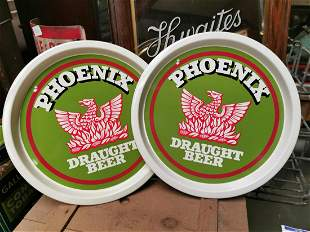 Two Phoenix draught beer advertising trays.