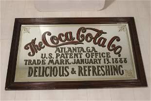The Coca Cola Co. advertising mirror.