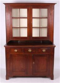 An Early 19th c. Pennsylvania Walnut Stepback Cupboard