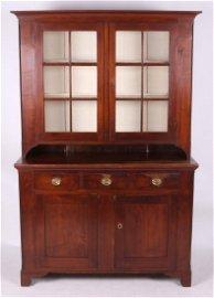 An Early 19th c. Pennsylvania Walnut Stepback Cupboard