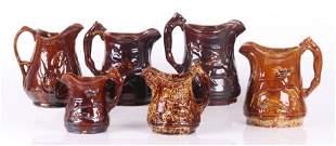 Six Pieces of Pottery Rockingham Glazed Pitchers