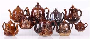 Nine Rockingham Glazed Pottery Teapots