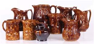 Rockingham Glazed Pottery Pitchers Including Pairs