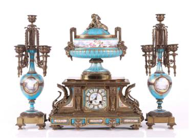 A Sevres Type Bronze Clock with Candelabra